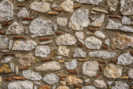 Stone wall with old rock