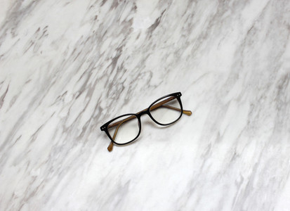 Eyeglasses on marble background