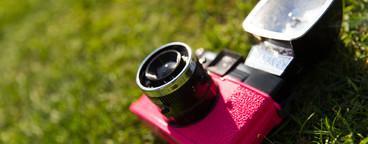 Retro camera in grass