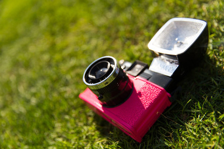 Retro camera in grass