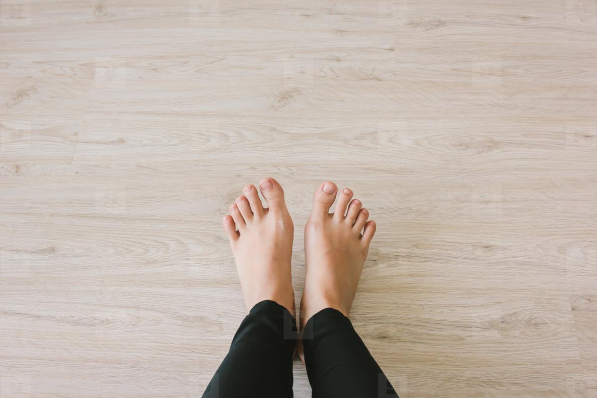 Selfie bare feet on wooden floor