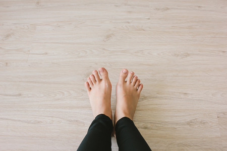 Selfie bare feet on wooden floor