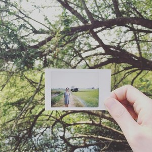 Girl hand holding instant photo
