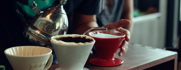 Barista brews a cups coffee