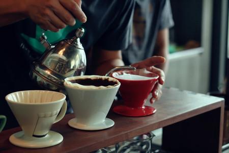 Barista brews a cups coffee