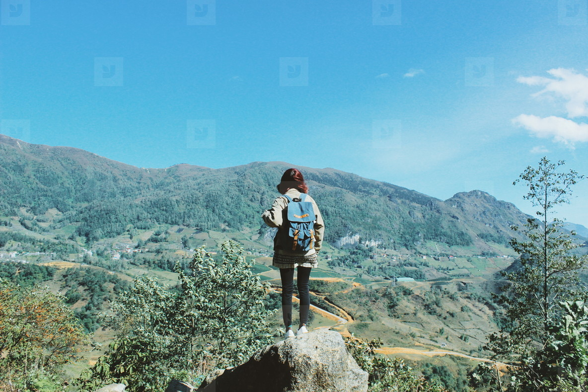 Young girl on top of mountain