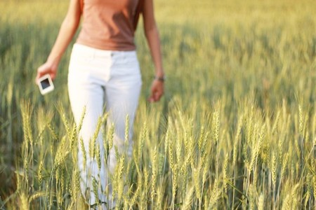 Young girl in wheat field 02
