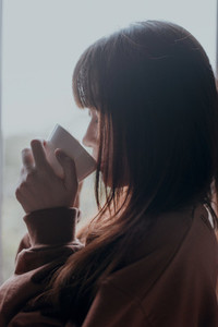 Young girl drinking a cup of coffee