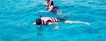 Snorkling in blue ocean