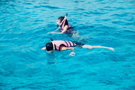 Snorkling in blue ocean