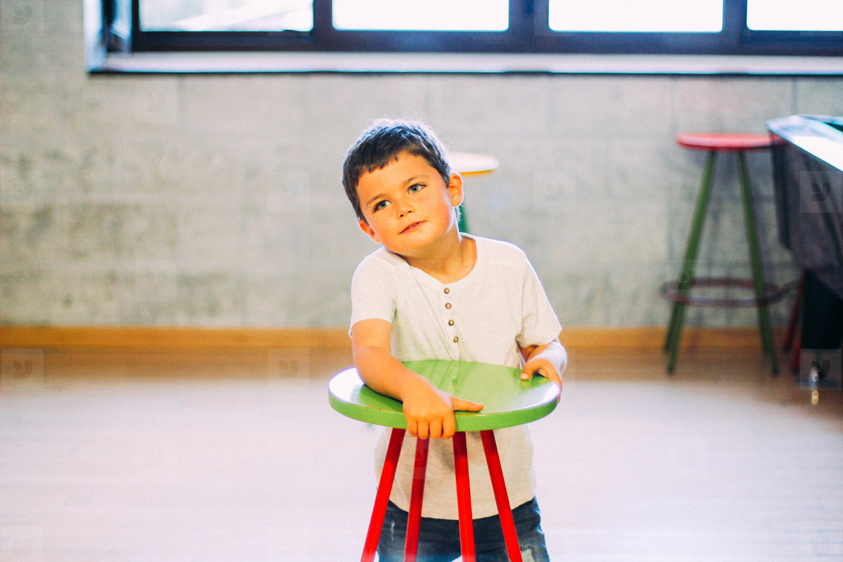 little boy with chair