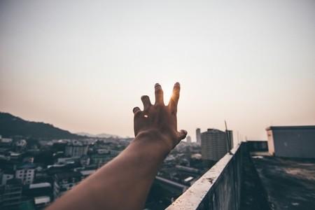 Hand holding sunset