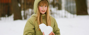 school girl with snow heart