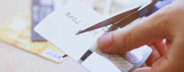 cutting credit card with scissor