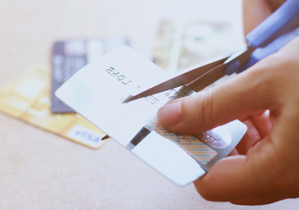 cutting credit card with scissor