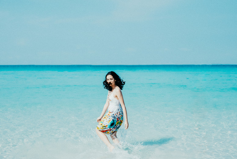 Young woman on beach  02