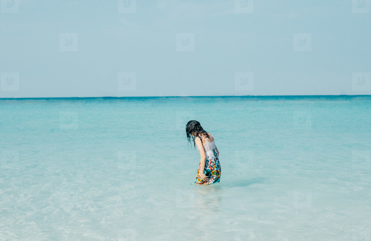 Young woman on beach  03
