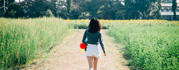 Back view of young woman walking