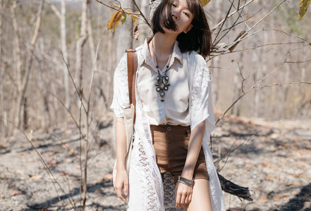 Young pretty girl in forest 01