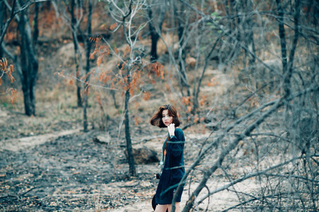 Young pretty girl in forest 06