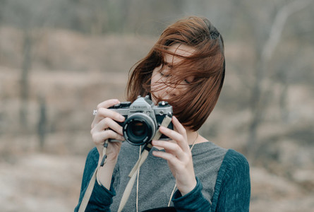 Young pretty girl holding camera