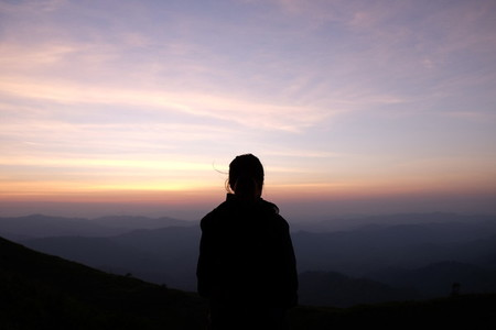 Silhouette of woman on sunrise