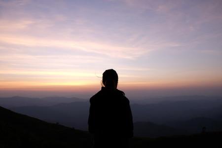Silhouette of woman on sunrise