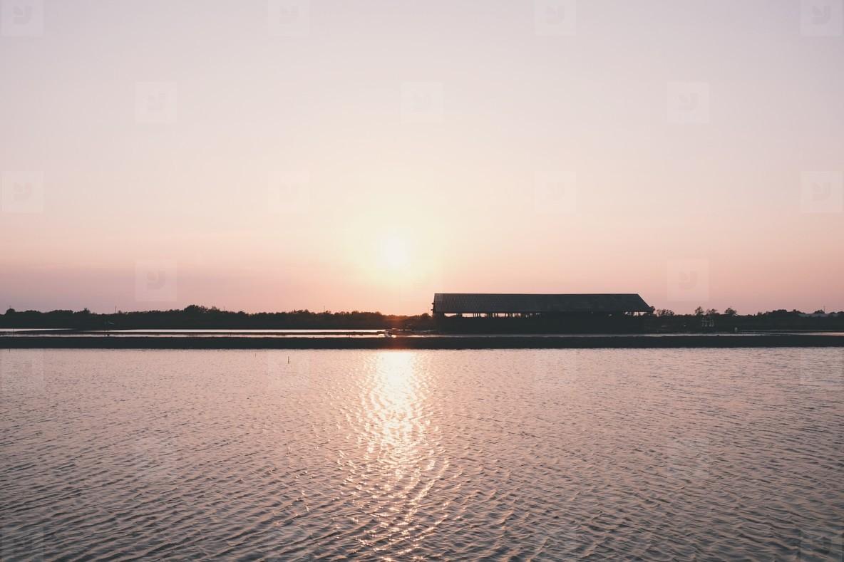 Silhouette of sea salt farm
