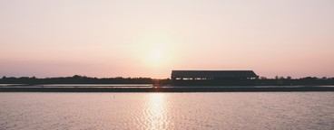 Silhouette of sea salt farm