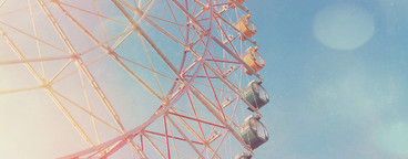 Colorful ferris wheel on sky