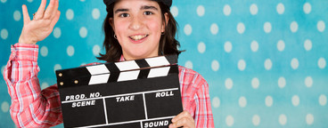Teenage girl with a film clapper