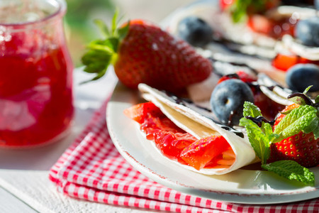 Crepes with strawberries and blu