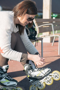 Woman tying skates