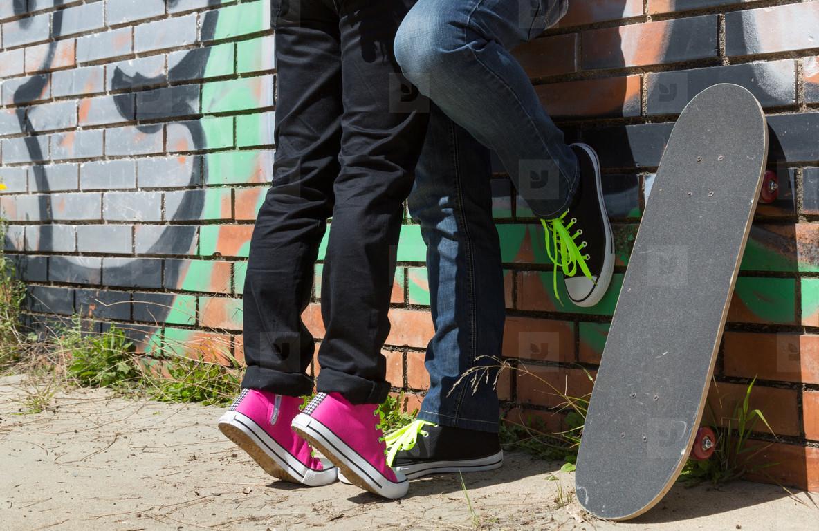 Couple of guys with his skateboa