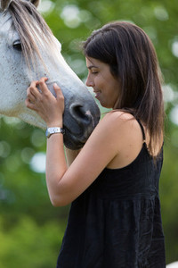 Young woman with her horse