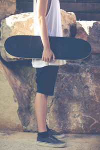 Young boy with his skateboard