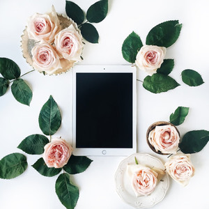 Tablet and rose buds