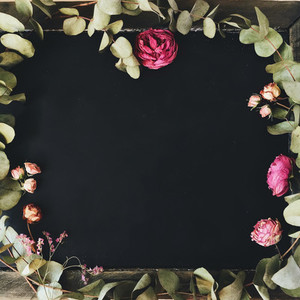 Floral frame on chalkboard