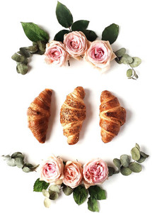 Croissants and rose buds