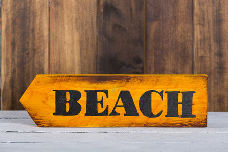 Direction sign with beach