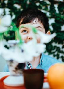 Boy behind Flowers