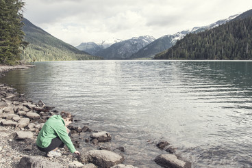 Girl by scenic lake