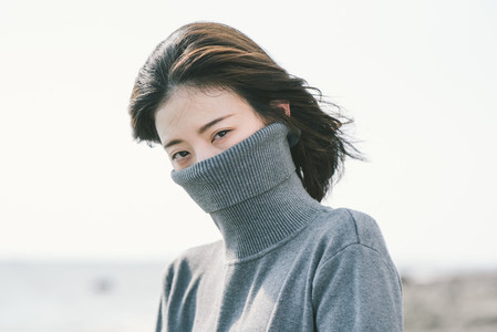 Young woman hiding her face