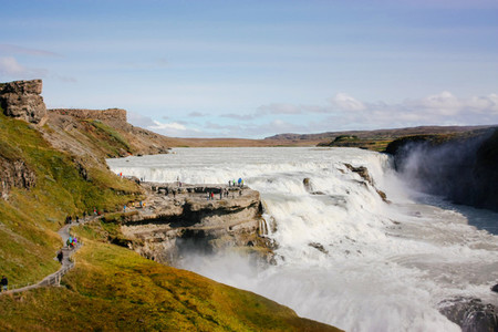 Gullfoss waterfall with people on rocks in Iceland
