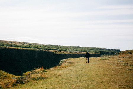 Alone man walking on the Icelandic landscape