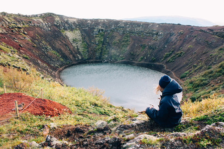 Lake hidden in eruption crater and girl  volcano landscape in Iceland