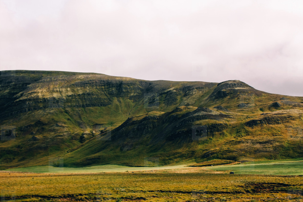 Icelandic landscape of green mountains