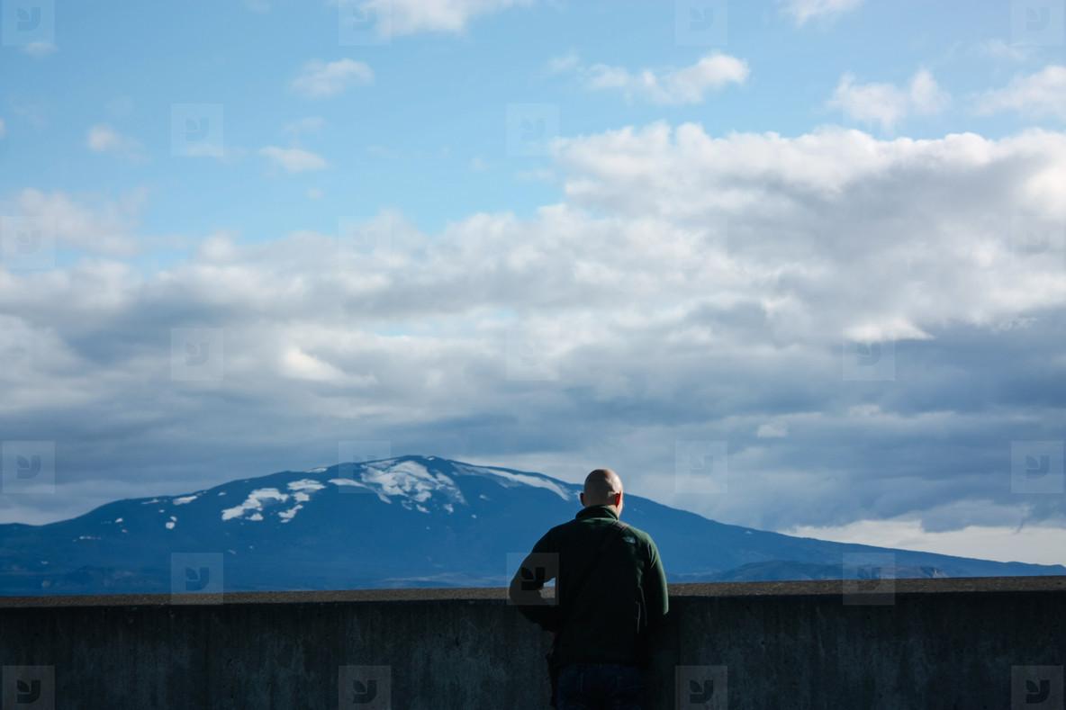 Man looking at Icelandic mountain