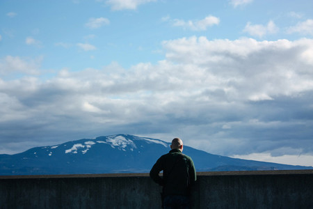 Man looking at Icelandic mountain