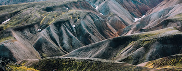 Icelandic landscape with mountain tourist in Landmannalaugar